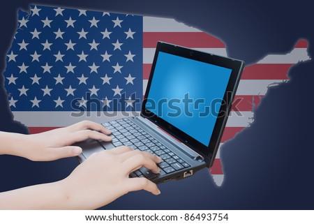 Hand pushing laptop keyboard with USA flag.