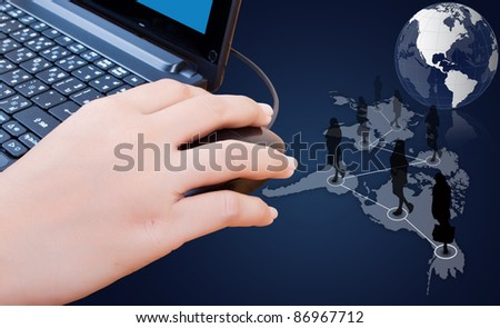 Hand pushing laptop mouse with social network.