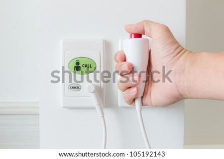 hand pushing nurse call button