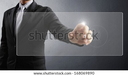 hand pushing on  touch screen interface