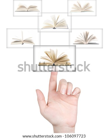 Hand pushing on touch screen with book. Electronic library concept