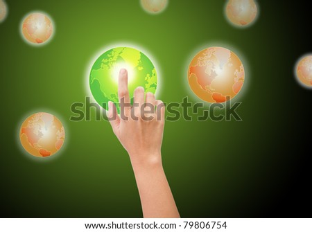 hand pushing the green world button