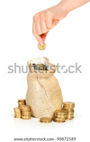 hand put coin in bag with money isolated on white, investment or growth concept