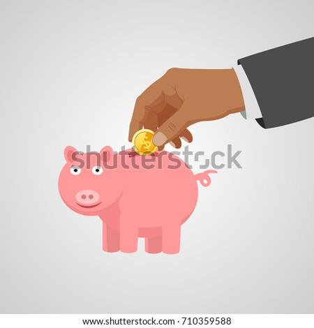 Hand put coin piggy save the money.