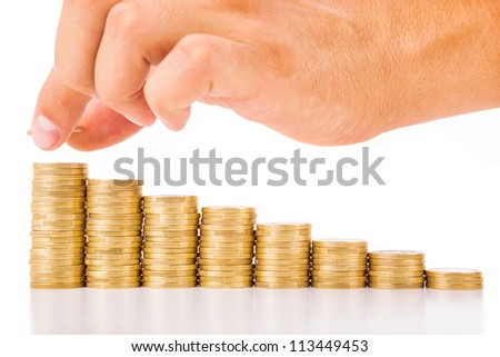 Hand put coin to money staircase , isolated on white