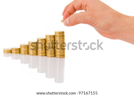 Hand put coin to money staircase, isolated on white