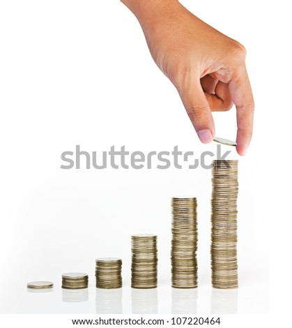 Hand put coin to money staircase isolated on white background - stock photo