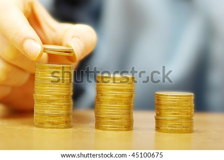Hand put coin to money staircase isolated on white background