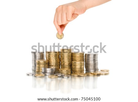 Hand put coin to money staircase with reflection