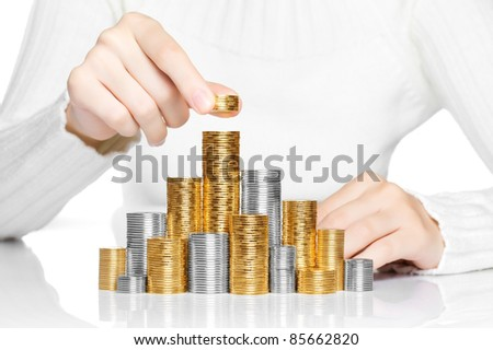 Hand put coin to stack, investment or growth concept