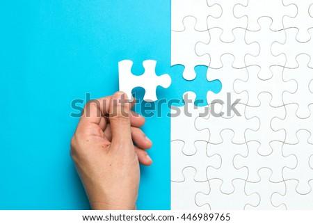 hand put the last piece of...