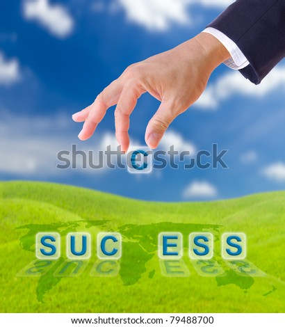 hand puting letter c to  success word on blue sky , business concept