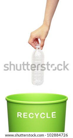 hand putting a plastic bottle into a recycling bin