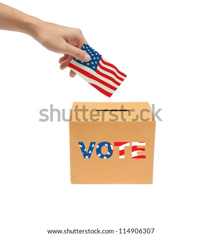 Hand putting a voting ballot into the box isolated on white background.