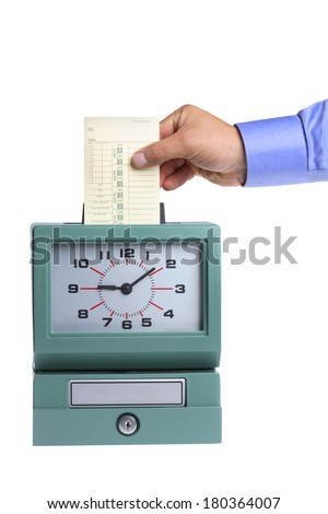 hand putting card in time clock ...