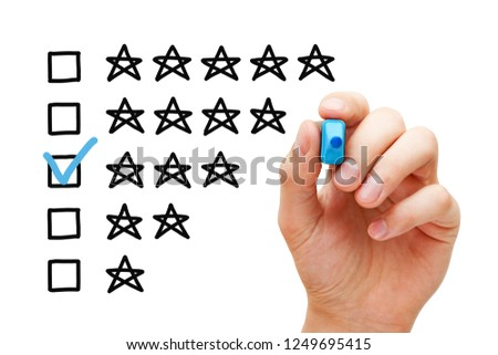 Hand putting check mark with blue marker on average three star rating.