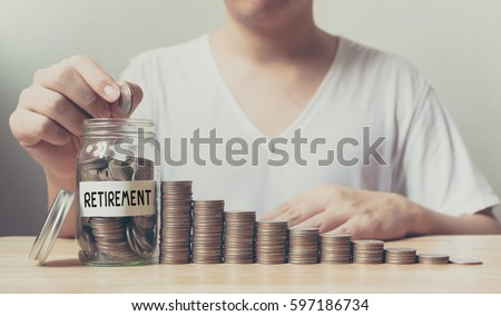 Hand putting coins in jar word retirement with money stack step growing growth saving money, Concept finance business investment
