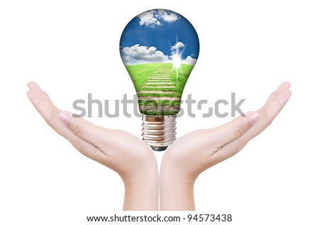 Hand putting light bulb for save world.