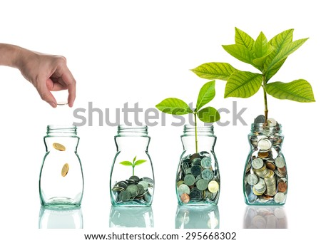 Hand putting mix coins and seed in clear bottle on white background,Business investment growth concept