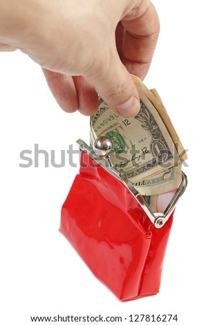 Hand putting money into red purse  isolated on white