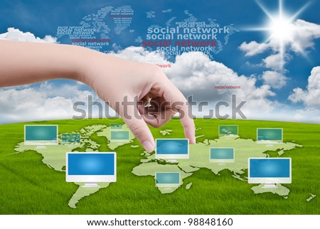 Hand putting monitor for Social Network communication. - stock photo