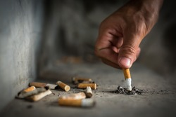 Hand putting out a cigarette,cigarette butt