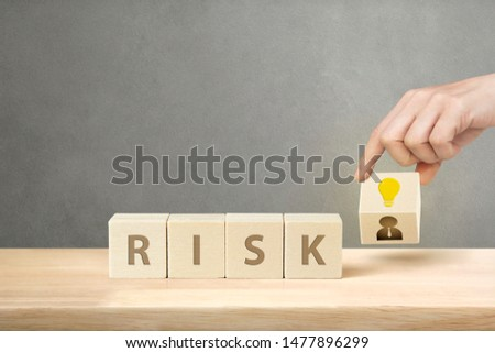 Hand Putting Wood Cube Block of Creative Businessman Symbol to Risk of Business with Copy Space, Management and Leadership Concept. #1477896299