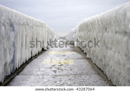 Hand rails coated with winter ice from Lake Michigan form a cold vanishing point linear prospective
