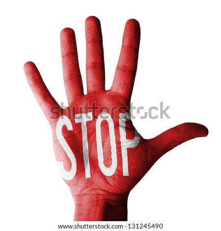 Hand raised gesture with stop sign painted, multi conceptual purposes- isolated on white background