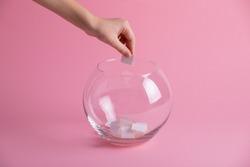 Hand randomly picks a paper from a glass bowl, random name ballot, simple raffle