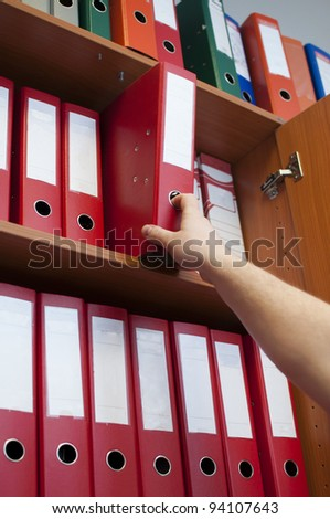 hand reaching down to the binder