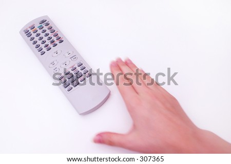 Hand reaching for television remote