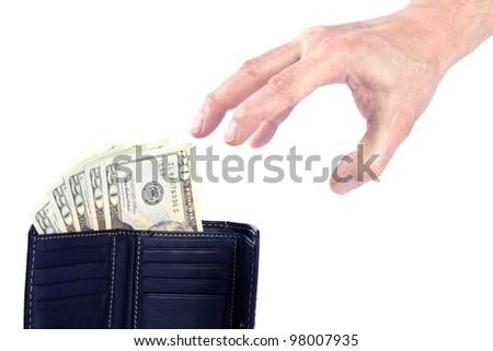 Hand Reaching for Twenty US Dollar Bills