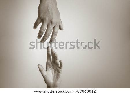 Hand reaching out to help another. People helping each other.  #709060012