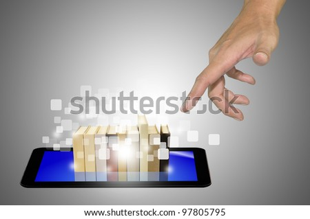 Hand reaching Stack of Book over Touch Screen Tablet PC in E-book concept