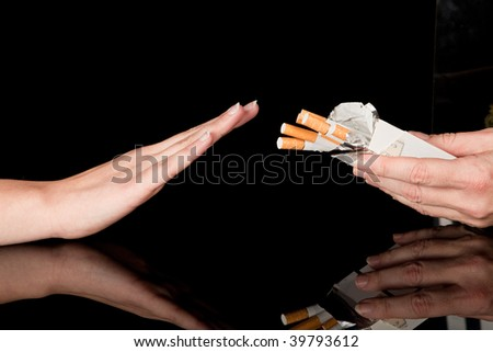 Hand refusing the cigarettes offered to her