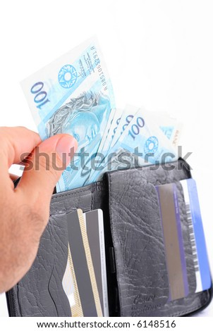 Hand removing money of a wallet. - stock photo