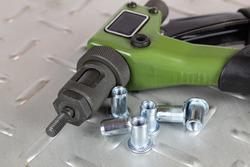 Hand rivet to install steel threaded rivets.