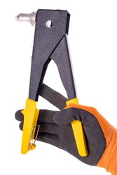 Hand riveter for assembly work. Accessories for mechanics used in mechanical work. Light background.