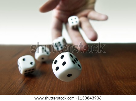 Hand & Rolling Dices  #1130843906