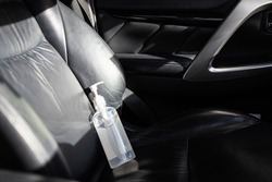 Hand sanitizer placed on car seat and exposed to sun in sunny day,do not keep alcohol antiseptic gel in the car,could start a fire,flammable objects,cause danger if parked in the sunshine,very hot day