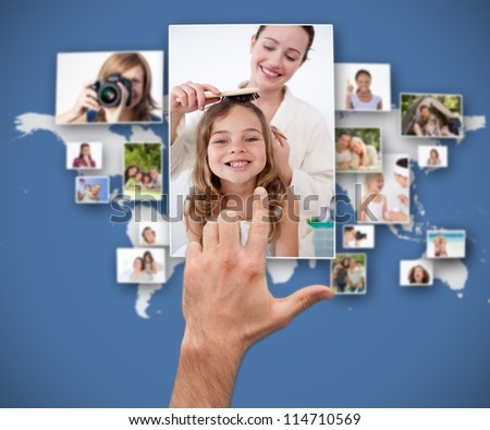 Hand selecting picture from interface