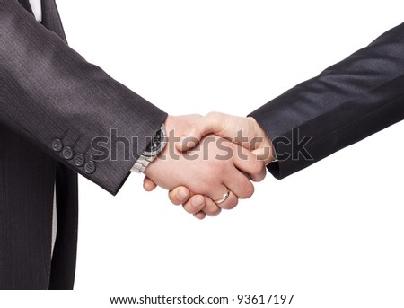 Hand shake between a businessman and a businesswoman isolated on white closeup in studio isolated portrait on white background