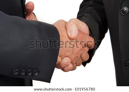 Hand shake between a businessmans isolated on white