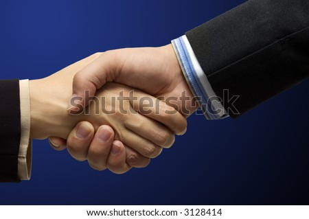 Hand shake - hand shake in front of a blue background