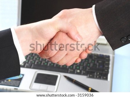 Hand shake of two people. Businessmen.