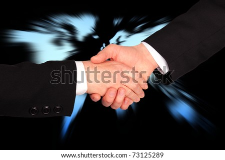 Hand shaking in business with world map in background
