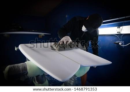 Hand shaper shaping a surfboard #1468791353