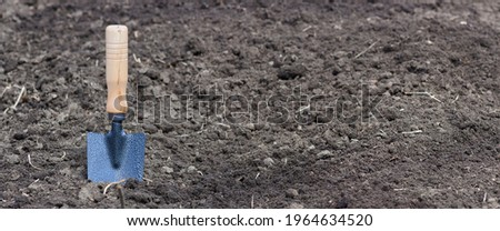Hand shovel for the garden in the gunt. Garden tools Stock photo ©