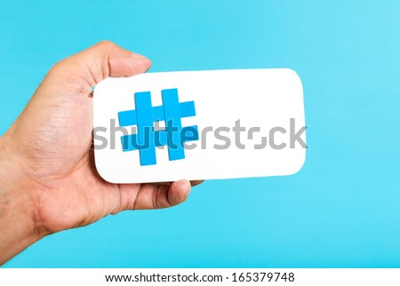 hand showing a hashtag symbol   ...